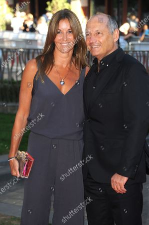 Ron Dennis (GBR) McLaren Executive Chairman and his girlfriend Carol Weatherall (GBR). Rush Film Premiere, Odeon Leicester Square, Leicester Square, London, 2 September 2013.