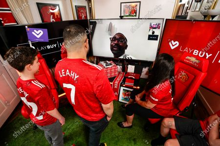HOME GOAL: Christmas came early for Manchester United superfan, Shaun Leahy, 31, yesterday, after he was surprised by footballing legend Andy Cole, who partnered with club partner, Laybuy to transform the key worker's Coventry home into the grounds of Old Trafford - complete with Christmas dinner, cheering crowds and his own personal dug-out. With this Christmas marking the first time in the club's 142-year history than fans will be unable to attend festive matches, Shaun and his family were treated to the club's first ever at-home Christmas hospitality experience to watch the Red Devil's winning match against Sheffield United on Thursday Night