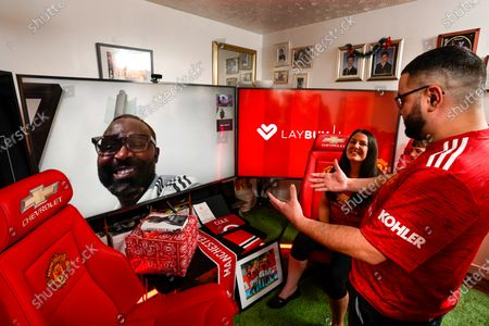 Stock Picture of HOME GOAL: Christmas came early for Manchester United superfan, Shaun Leahy, 31, yesterday, after he was surprised by footballing legend Andy Cole, who partnered with club partner, Laybuy to transform the key worker's Coventry home into the grounds of Old Trafford - complete with Christmas dinner, cheering crowds and his own personal dug-out. With this Christmas marking the first time in the club's 142-year history than fans will be unable to attend festive matches, Shaun and his family were treated to the club's first ever at-home Christmas hospitality experience to watch the Red Devil's winning match against Sheffield United on Thursday Night