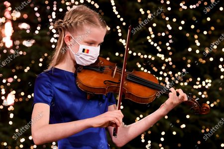 Princess Eleonore of the Belgian Royal Family wearing a face mask records Christmas greetings at the Royal Palace during a Christmas concert rehearsal at Throne Room, decorated with an origami installation by Charles Kaisin, in Brussels, Belgium, 16 December 2020 (issued 18 December 2020).