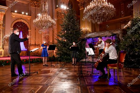 Princess Eleonore. Belgian Royals celebrate Christmas at the Royal Palace with a Christmas concert rehearsal by the Scala choir, Throne Room decorated with an origami installation by Charles Kaisin, recording of Christmas greetings by members of the Royal Family and a traditional Christmas photo