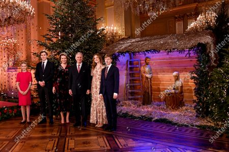 Princess Eleonore, Prince Gabriel, Queen Mathilde, King Philippe, Princess Elisabeth, Prince Emmanuel. Belgian Royals celebrate Christmas at the Royal Palace with a Christmas concert rehearsal by the Scala choir, Throne Room decorated with an origami installation by Charles Kaisin, recording of Christmas greetings by members of the Royal Family and a traditional Christmas photo