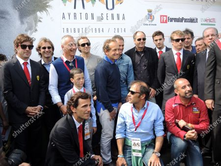 Stock Photo of Fernando Alonso (ESP) Ferrari, Jarno Trulli (ITA), Luca Badoer (ITA), Pierluigi Martinin (ITA), Andrea De Cesaris (ITA), Gerhard Berger (AUT), Jules Bianchi (FRA), Kimi Raikkonen (FIN) Ferrari, Pedro De La Rosa (ESP), Emanuele Pirro (ITA) and Ivan Capelli (ITA). Ayrton Senna and Roland Ratzenberger Tribute Weekend, Imola, San Marino, Italy, 1-4 May 2014.