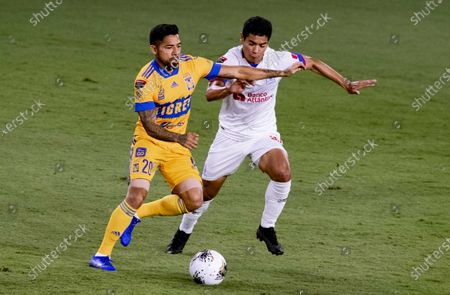 Javier Aquino of Tigres UANL (MEX) fights for the ball against Carlos Pineda of CD Olimpia (HON) during their CONCACAF Champions League Semi Finals match at the Orlando's Exploria Stadium on 19 December 2020, in Florida, USA. Photo by Victor Fraile / Power Sport Images
