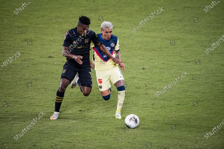 Leonardo Suarez of Club America (MEX) and Mark-Anthony Kaye of Los Angeles FC (USA)  in action during their CONCACAF Champions League Semi Finals match at the Orlando's Exploria Stadium
