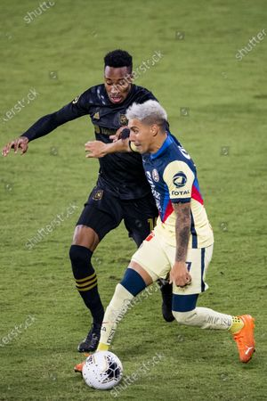 Stock Photo of Leonardo Suarez of Club America (MEX) and Mark-Anthony Kaye of Los Angeles FC (USA)  in action during their CONCACAF Champions League Semi Finals match at the Orlando's Exploria Stadium