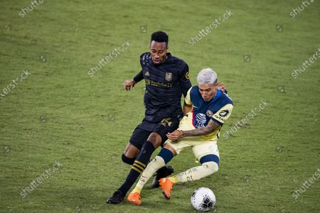 Stock Picture of Leonardo Suarez of Club America (MEX) and Mark-Anthony Kaye of Los Angeles FC (USA)  in action during their CONCACAF Champions League Semi Finals match at the Orlando's Exploria Stadium