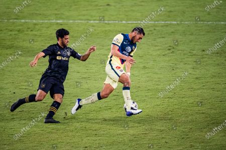 Carlos Vela of Los Angeles FC (USA) and Sebastian Caceres of Club America (MEX) in action during their CONCACAF Champions League Semi Finals match at the Orlando's Exploria Stadium