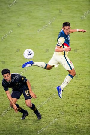 Sebastian Caceres of Club America (MEX) and Carlos Vela of Los Angeles FC (USA)  in action during their CONCACAF Champions League Semi Finals match at the Orlando's Exploria Stadium