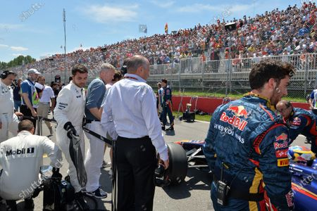 Rory Bremner (GBR) Impressionist and satirist and Ron Dennis (GBR) McLaren Executive Chairman on the grid. Formula One World Championship, Rd7, Canadian Grand Prix, Race Day, Montreal, Canada, Sunday 8 June 2014.