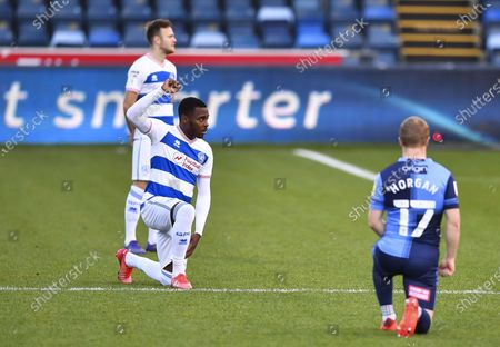 Bright Osayi-Samuel of QPR takes a knee in support of the Black Lives Matter movement prior to kick-off