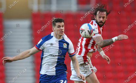 Stoke City's Stephen Fletcher battles with Blackburn Rovers Darragh Lenihan