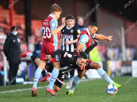 Stock Picture of Kyle Bennett of Grimsby Town battles with Lewis Spence and Jordan Clarke of Scunthorpe United