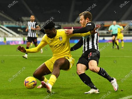 Ola Aina of Fulham fends off Ryan Fraser for Newcastle United