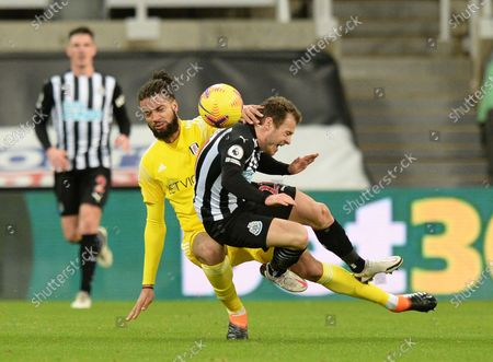 Michael Hector of Fulham takes out Ryan Fraser for Newcastle United