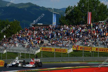 Dieter Quester (AUT) Surtees TS16 and Sebastian Vettel (GER) Red Bull Racing, BRM P160b. Formula One World Championship, Rd8, Austrian Grand Prix, Qualifying, Spielberg, Austria, Saturday 21 June 2014.