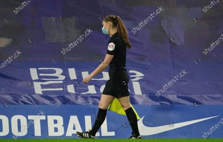 Lineswoman Sian Massey-Ellis wearing a face mask on the touchline