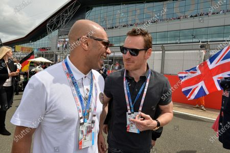 R-L: Michael Fassbender (GER) actor and Goldie (GBR) on the grid. Formula One World Championship, Rd9, British Grand Prix, Race Day, Silverstone, England, Sunday 6 July 2014.