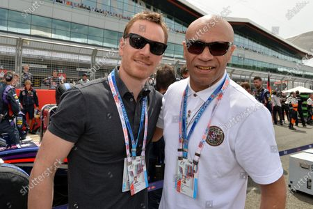Michael Fassbender (GER) actor and Goldie (GBR) on the grid. Formula One World Championship, Rd9, British Grand Prix, Race Day, Silverstone, England, Sunday 6 July 2014. BEST IMAGE