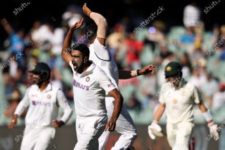Ravichandran Ashwin of India celebrates a wicket as Steven Smith of Australia is cought out