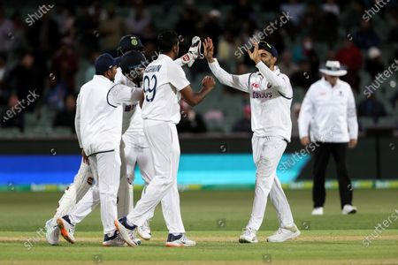 Virat Kohli Captain of India celebrates catching out Nathan Lyon of Australia