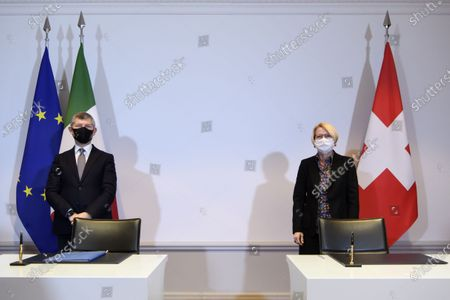 Ivan Scalfarotto (L), Italian Undersecretary for Foreign Affairs, and Swiss State Secretary Livia Leu (R) pose for a photograph before signing a bilateral state agreement in the field of radiometric controls at the borders, at Bellevue Palace, in Bern, Switzerland, 18 December 2020.