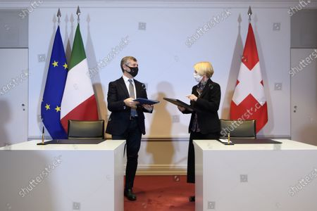 Ivan Scalfarotto (L), Italian Undersecretary for Foreign Affairs, and Swiss State Secretary Livia Leu (R) speak after signing a bilateral state agreement in the field of radiometric controls at the borders, at Bellevue Palace, in Bern, Switzerland, 18 December 2020.