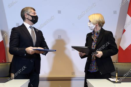 Stock Photo of Ivan Scalfarotto (L), Italian Undersecretary for Foreign Affairs, and Swiss State Secretary Livia Leu (R) speak after signing a bilateral state agreement in the field of radiometric controls at the borders, at Bellevue Palace, in Bern, Switzerland, 18 December 2020.