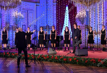 Scala choir sings during the traditional Christmas ceremony at the Royal Palace in Brussels, . The room has been decorated with an origami installation by artist Charles Kaisin