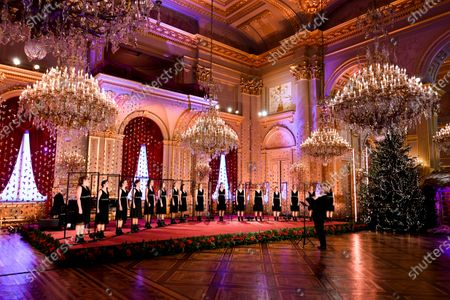Stock Picture of Scala choir sings during the traditional Christmas ceremony at the Royal Palace in Brussels, . The room has been decorated with an origami installation by artist Charles Kaisin