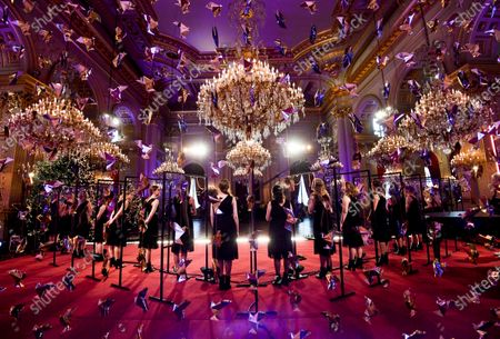 Stock Image of Scala choir sings during the traditional Christmas ceremony at the Royal Palace in Brussels, . The room has been decorated with an origami installation by artist Charles Kaisin