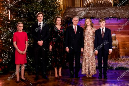 Stock Photo of Belgium royals, from left, Princess Eleonore, Prince Gabriel, Queen Mathilde, King Philippe, Princess Elisabeth and Prince Emmanuel pose for a photographer prior to the traditional Christmas ceremony at the Royal Palace in Brussels