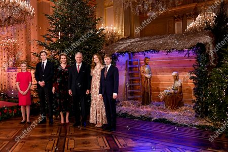 Belgium royals, from left, Princess Eleonore, Prince Gabriel, Queen Mathilde, King Philippe, Princess Elisabeth and Prince Emmanuel pose for a photographer prior to the traditional Christmas ceremony at the Royal Palace in Brussels
