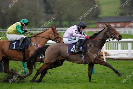 Wouldubewell and Tom Bellamy takes Gio's Girl and James Best ground at the last but survives a stewards enquiry to win the Watch attheraces.com Mares' Novices' Hurdle at Uttoxeter.