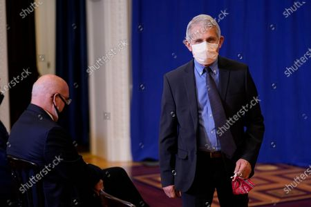 Director of the National Institute of Allergy and Infectious Diseases Dr. Anthony Fauci, arrives to watch Vice President Mike Pence, his wife Karen Pence, and U.S. Surgeon General Jerome Adams receive a Pfizer-BioNTech COVID-19 vaccine shot at the Eisenhower Executive Office Building on the White House complex, in Washington