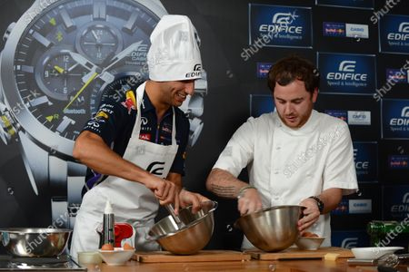 Daniel Ricciardo (AUS) Red Bull Racing at a Casio Cook Off event with Tom Sellers (GBR) Chef. Formula One World Championship, Rd13, Italian Grand Prix, Monza, Italy, Preparations, Thursday 4 September 2014.
