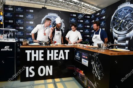 Stock Picture of Daniel Ricciardo (AUS) Red Bull Racing and Christian Horner (GBR) Red Bull Racing Team Principal at a Casio Cook Off event with Tom Sellers (GBR) Chef. Formula One World Championship, Rd13, Italian Grand Prix, Monza, Italy, Preparations, Thursday 4 September 2014.