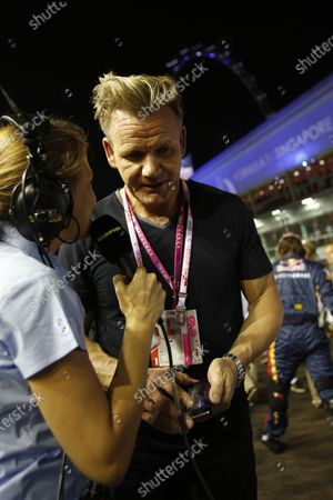 Gordon Ramsay (GBR) talks with Jennie Gow (GBR) BC on the grid. Formula One World Championship, Rd14, Singapore Grand Prix, Marina Bay Street Circuit, Singapore, Race Day, Sunday 21 September 2014.