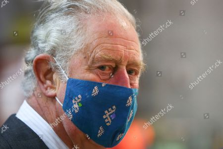 Prince Charles, wears a mask because of the coronavirus pandemic, as he visits Royal Mail's Delivery Office. Prince Charles visited the Royal Mail in Cirencester to recognise the vital public services that the country's postal workers provide, especially during the coronavirus pandemic and in the run-up to Christmas