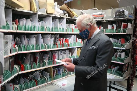 Prince Charles, wearing a mask because of the coronavirus pandemic, helps to sort the mail on a visit to Royal Mail's Delivery Office. Prince Charles visited the Royal Mail in Cirencester to recognise the vital public services that the country's postal workers provide, especially during the coronavirus pandemic and in the run-up to Christmas