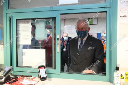 Prince Charles, wearing a mask because of the coronavirus pandemic, visits Royal Mail's Delivery Office. Prince Charles visited the Royal Mail in Cirencester to recognise the vital public services that the country's postal workers provide, especially during the coronavirus pandemic and in the run-up to Christmas