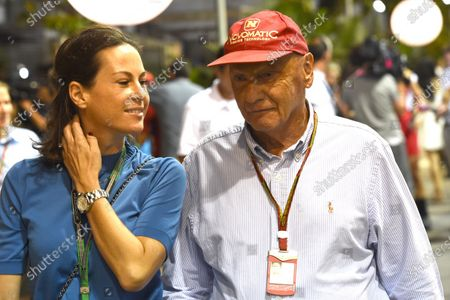 Niki Lauda (AUT) and girlfriend Birgit Wetzinger (AUT). Formula One World Championship, Rd14, Singapore Grand Prix, Marina Bay Street Circuit, Singapore, Qualifying, Saturday 20 September 2014.