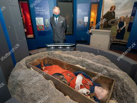 Prince Charles visited the Corinium Museum and viewed their interactive galleries depicting the story of the life in the Cotswolds from 40,000 years ago, right up to the early Corinium era (early Roman times) including Bronze Age and Iron Age artefacts. HRH toured the new 'Stone Age to Corinium Gallery' and saw some of their key exhibits and some newly acquired pieces. The prince looks at exhibit an of Lady Getty