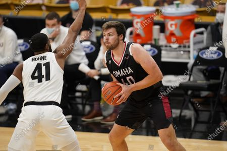 Omaha forward Matt Pile (40) looks to pass as Colorado forward Jeriah Horne (41) defends in the second half of an NCAA college basketball game, in Boulder, Colo. Colorado won 91-49