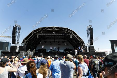 Fans listen to Jenson Button and Guy Martin on stage.