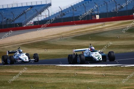 Jenson Button drives a 1982 Williams FW08B six-wheeled car, ahead of Guy Martin in a 1983 Williams FW08C.