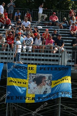 Fans in the grandstand and a flag remembering Ronnie Peterson (SWE). Formula One World Championship, Rd13, Italian Grand Prix, Monza, Italy, Race Day, Sunday 7 September 2014.