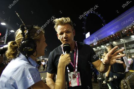 Gordon Ramsay (GBR) talks with Jennie Gow (GBR) BBC on the grid. Formula One World Championship, Rd14, Singapore Grand Prix, Marina Bay Street Circuit, Singapore, Race Day, Sunday 21 September 2014. BEST IMAGE