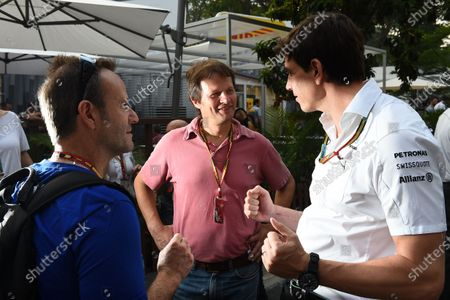 (L to R): Rubens Barrichello (BRA) TV Globo Commentator, Michael Scmhidt (GER) Journalist and Toto Wolff (AUT) Mercedes AMG F1 Director of Motorsport. Formula One World Championship, Rd14, Singapore Grand Prix, Marina Bay Street Circuit, Singapore, Race Day, Sunday 21 September 2014.