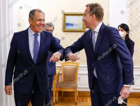 In this photo released by the Russian Foreign Ministry Press Service, Russian Foreign Minister Sergey Lavrov, left, and President of the World Economic Forum Borge Brende greet each other prior to their talks in Moscow, Russia